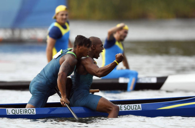 Brazil's Erlon De Souza Silva and Brazil's Isaquias Queiroz Dos Santos celebrate after the Men's Canoe Double (C2) 1000m final at the Lagoa Stadium during the Rio 2016 Olympic Games in Rio de Janeiro on August 20, 2016. / AFP PHOTO / Damien MEYER